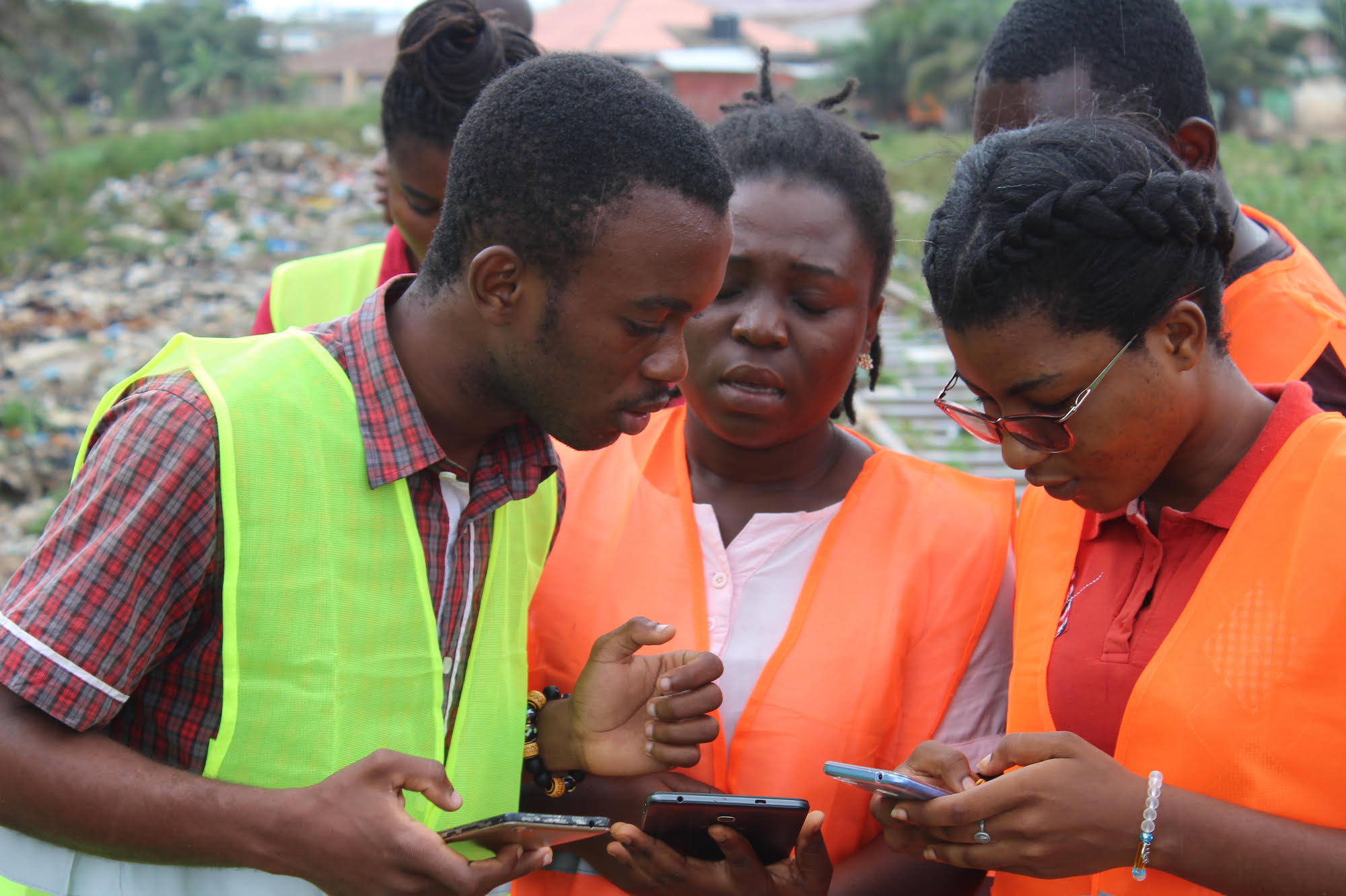 Accra-open-cities-africa-Chris working with other mappers in the field to collect data using mobile survey apps.jpg